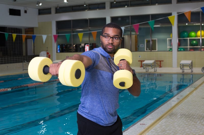 aqua boxing instructor shows aerobics moves