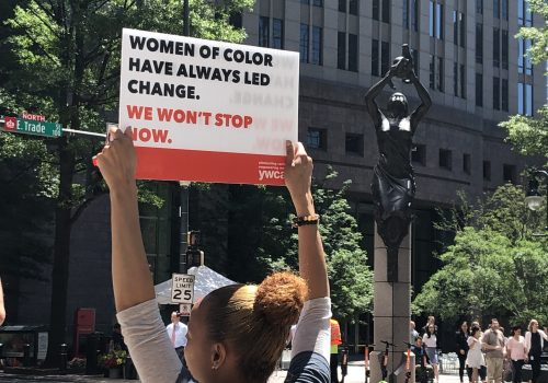 Participant holding sign at YWCA's SAR 2019